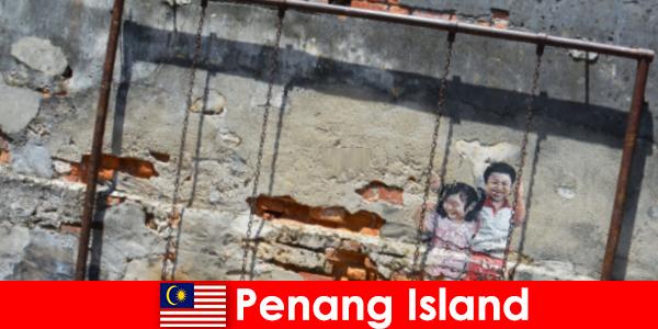 Arte de rua fascinante e diversificada na Ilha de Penang surpreende estranhos